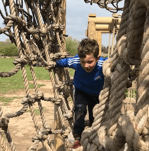 Boy through ropes square